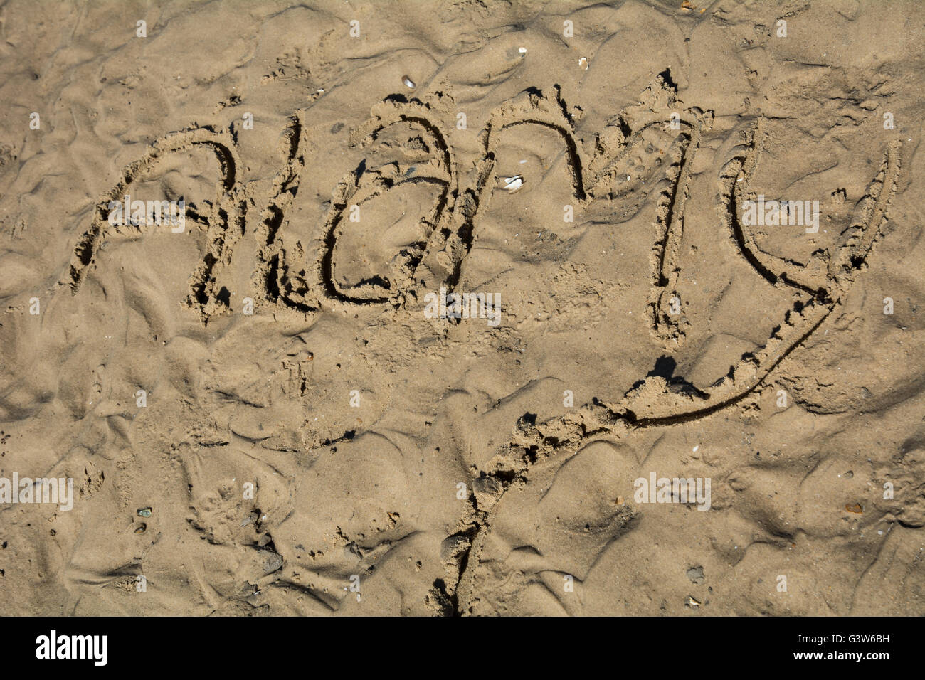 The word 'Alamy' drawn in the sand. - Stock Image