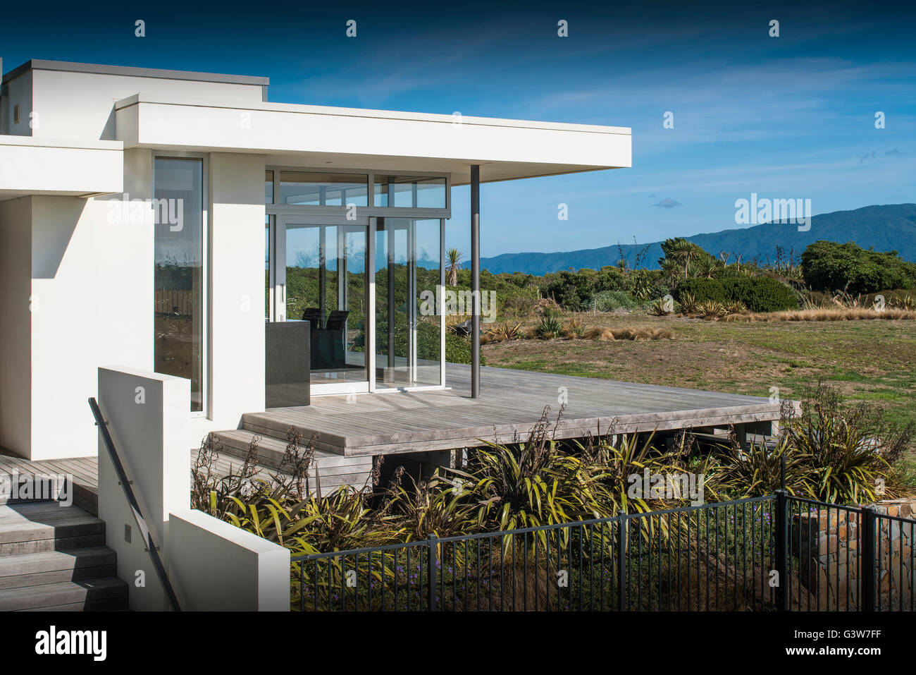Shot of deck looking over sea. Waikanae House, Peka Peka - Kapiti Coast, New Zealand. Architect: Herriot Meluish Stock Photo