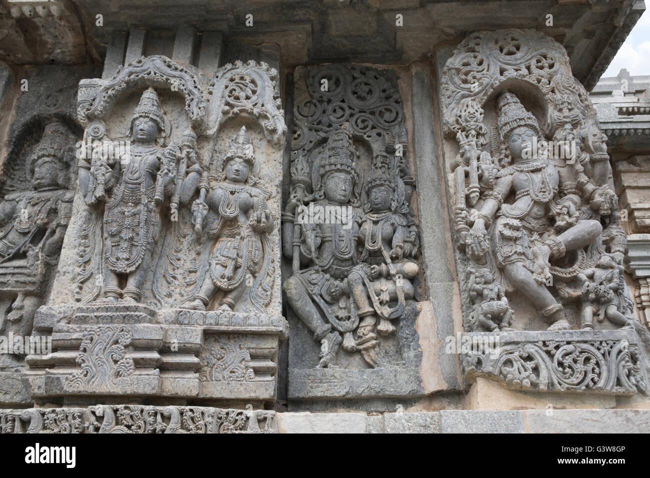 Ornate bas relief and sculptures of Hindu deities, Kedareshwara Temple, Halebid, Karnataka, india. - Stock Image