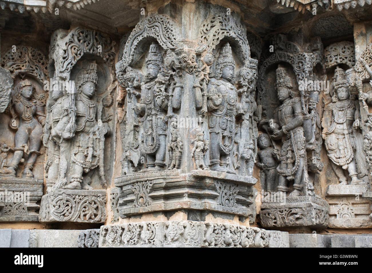 Ornate bas relieif and sculptures of Hindu deities, Kedareshwara Temple, Halebid, Karnataka, india. - Stock Image