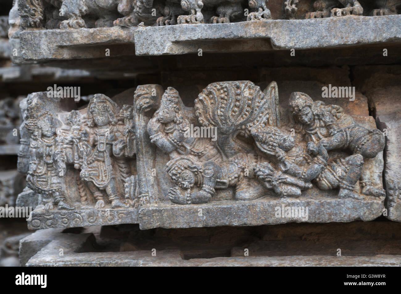 Ornate bas reliefs depicting scene from Mahabharata, Kedareshwara temple, Halebidu, Karnataka, india. - Stock Image