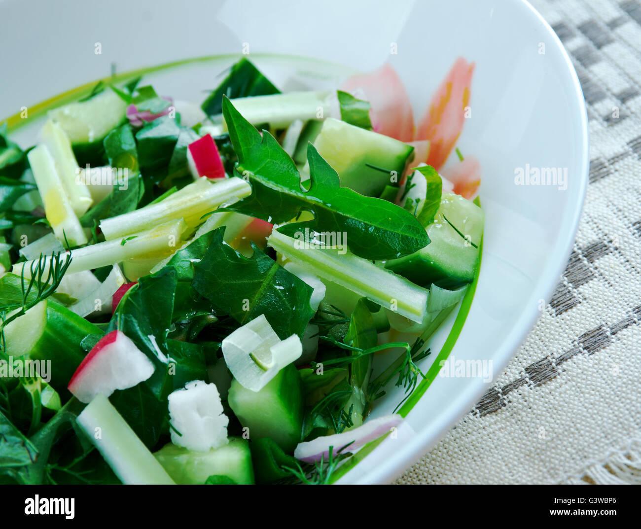Traditional Slavic spring salad of dandelions - Stock Image