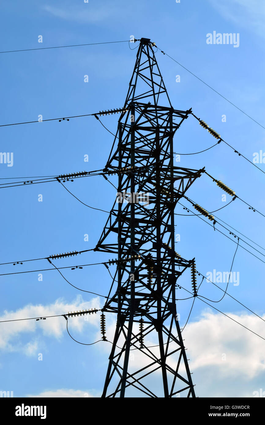 Reliance power lines closeup on the sky background - Stock Image