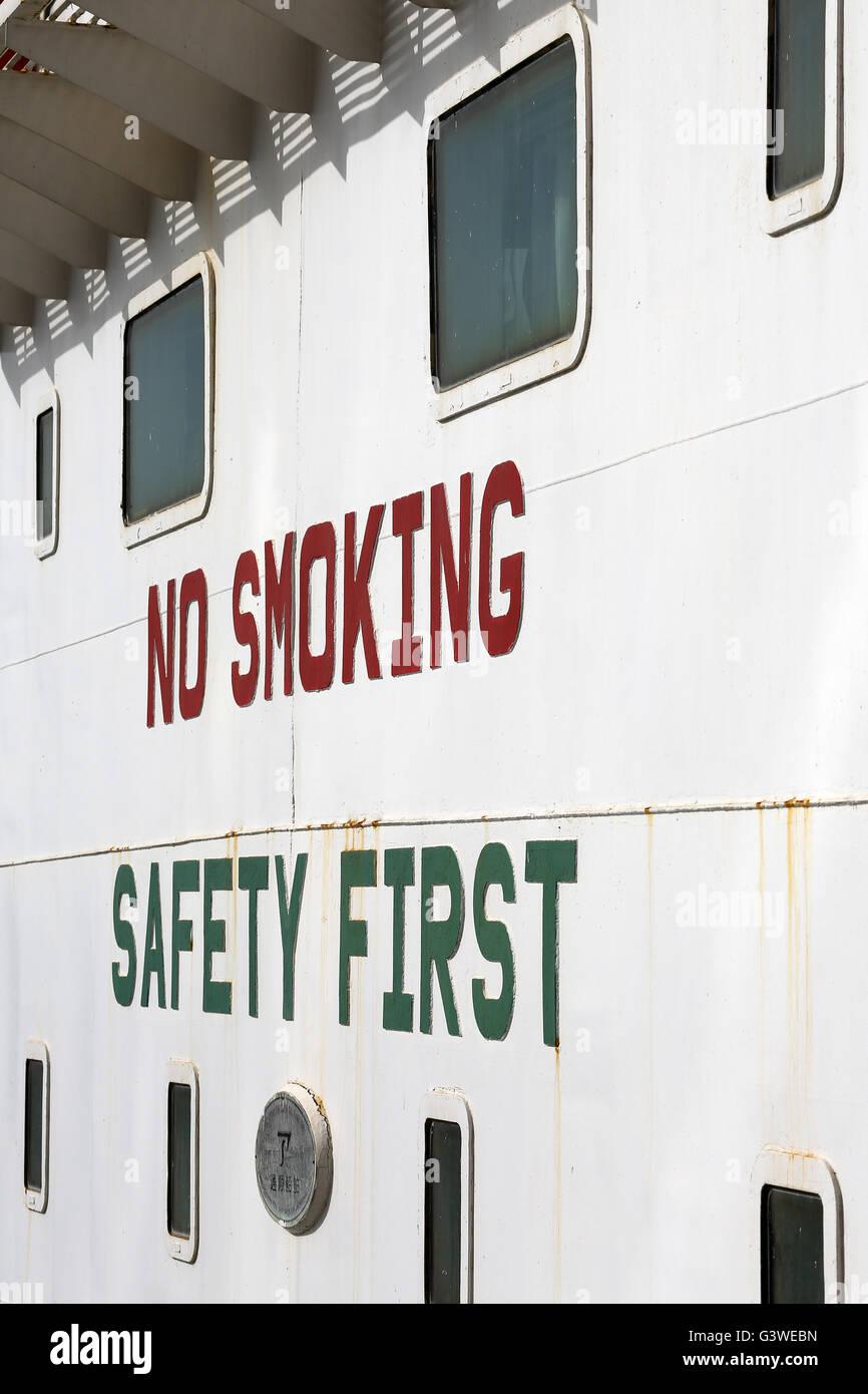 Safety sign on Oil tanker supplying fuel oil (bunkers) to Passenger ship. Port of Dubai .UAE Stock Photo