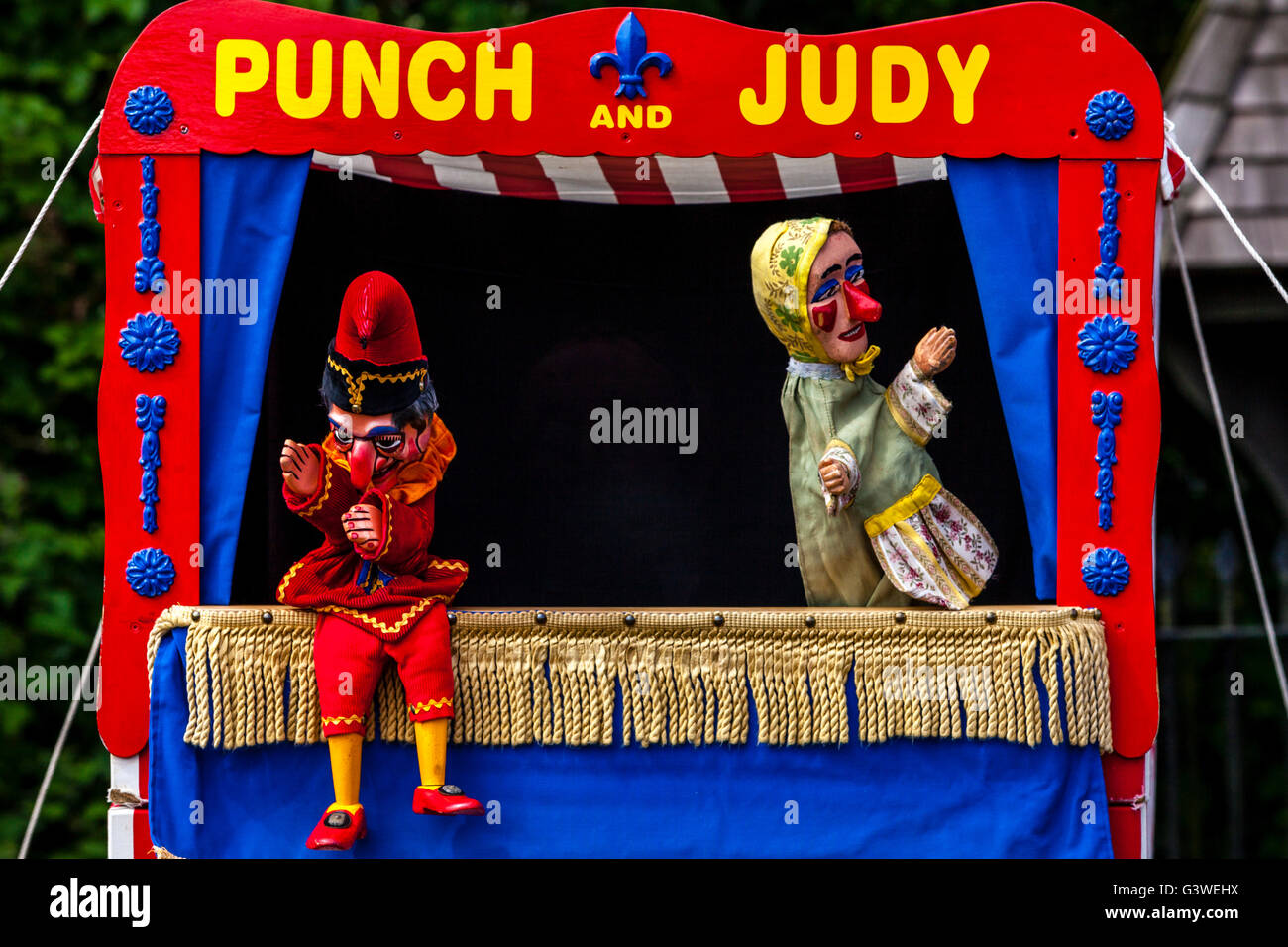 A Traditional Punch and Judy Show Performed At The Annual Medieval Fair Of Abinger, Surrey, UK - Stock Image
