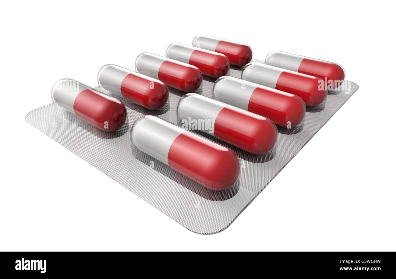 red and white pills in blister isolated on white. - Stock Image