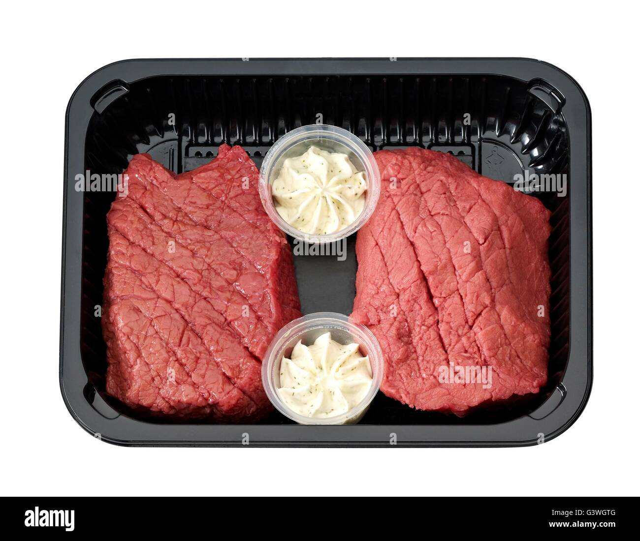 Beef Steak Packaged on tray with butter. - Stock Image