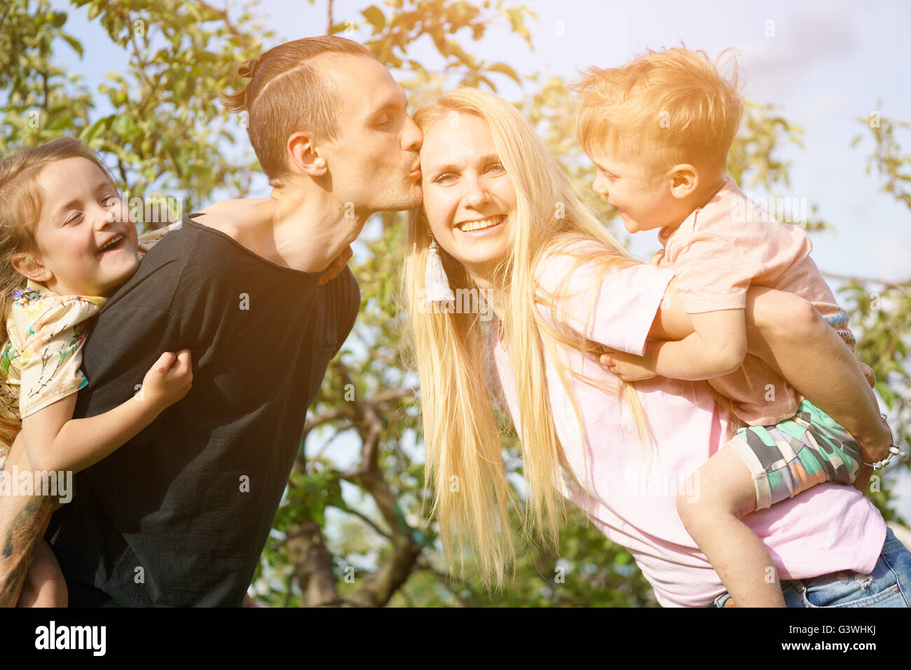 Portrait of a happy family outdoors - Stock Image