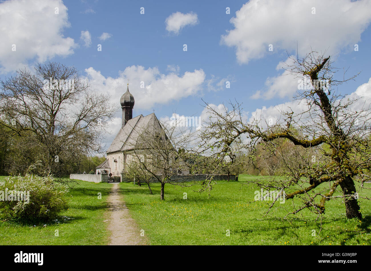 Typically Bavarian - white and blue sky and a bulbous spire! - Stock Image