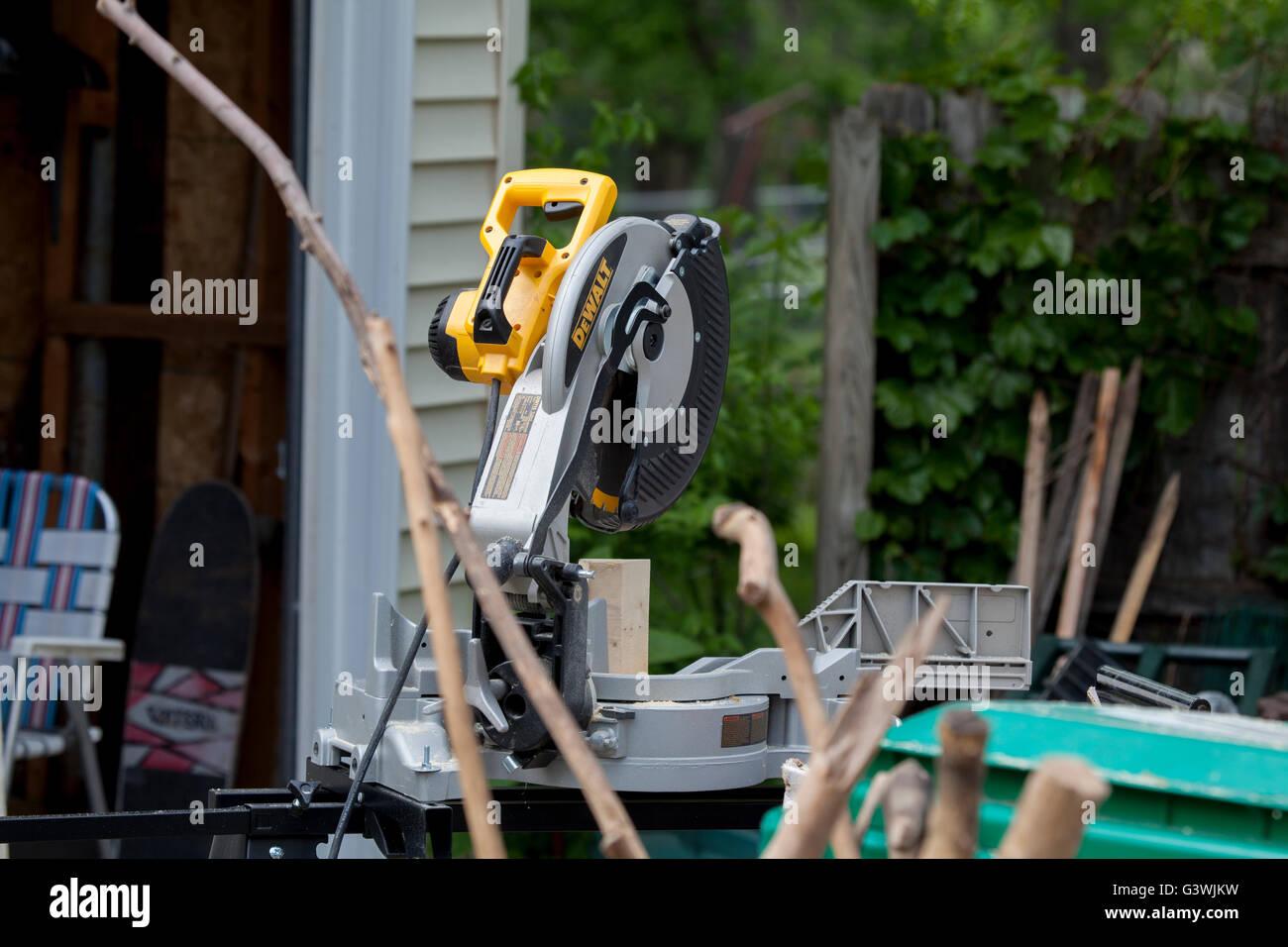 """Dewalt 12"""" miter saw on jobsite. Stock Photo"""