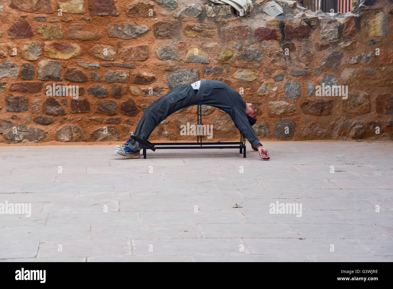 A man doing excercise early morning in the park at Quli Khan'sTomb in New Delhi, India - Stock Image