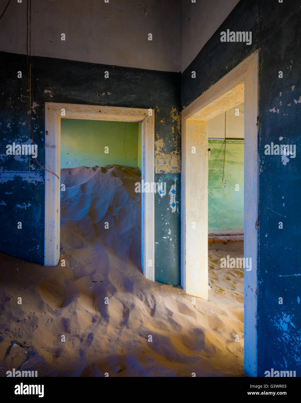 Kolmanskop (Afrikaans for Coleman's hill, German: Kolmannskuppe) is a ghost town in the Namib desert in southern - Stock Image