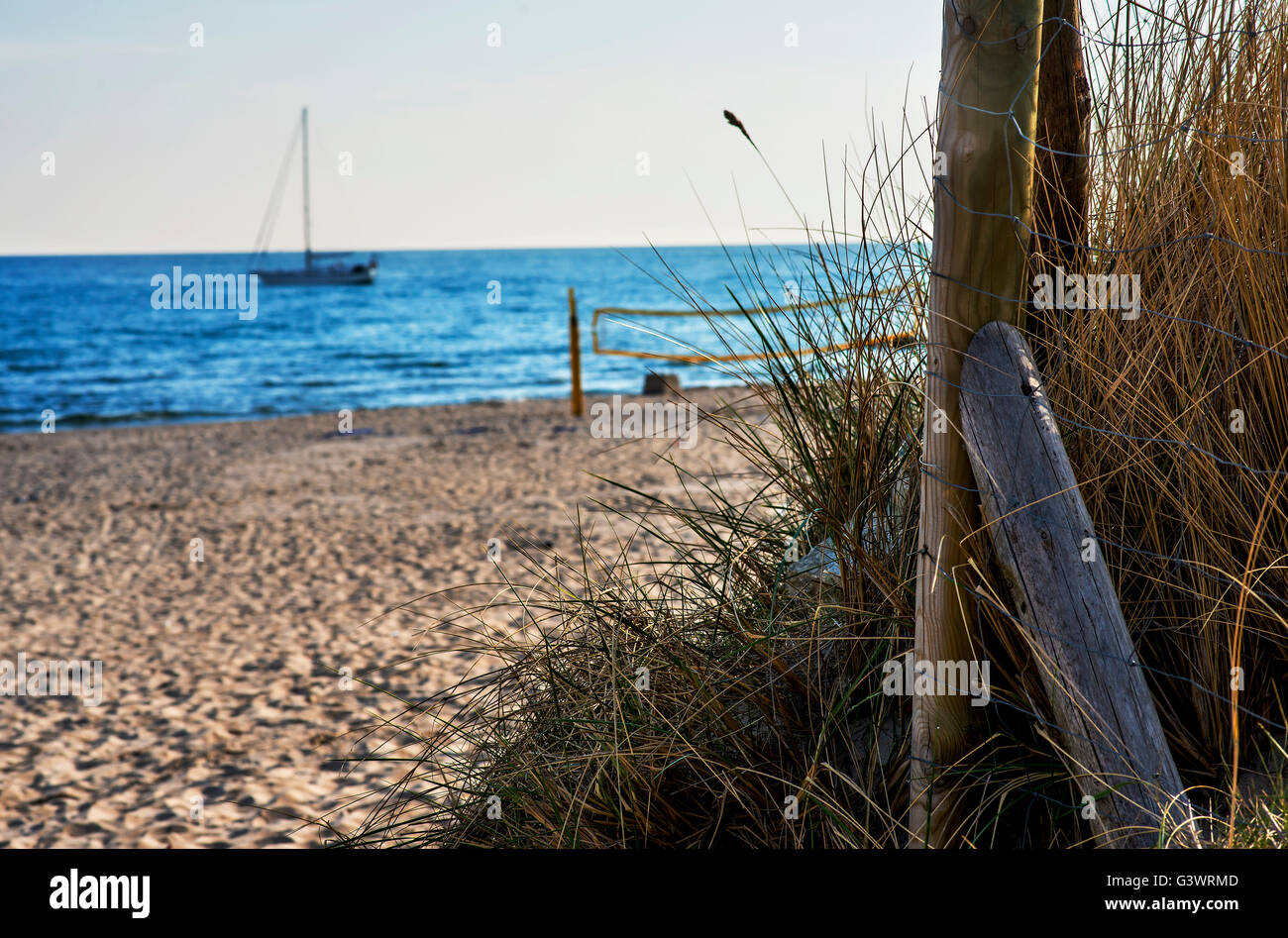Sailboat anchored on a beach in the Baltic Sea - Stock Image