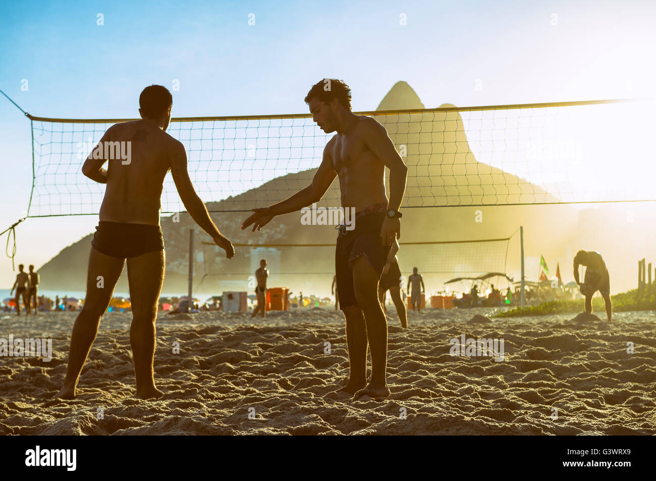 RIO DE JANEIRO - MARCH 20, 2016: Young Brazilians shake hands at beach volleyball, which Brazil is favored to win - Stock Image