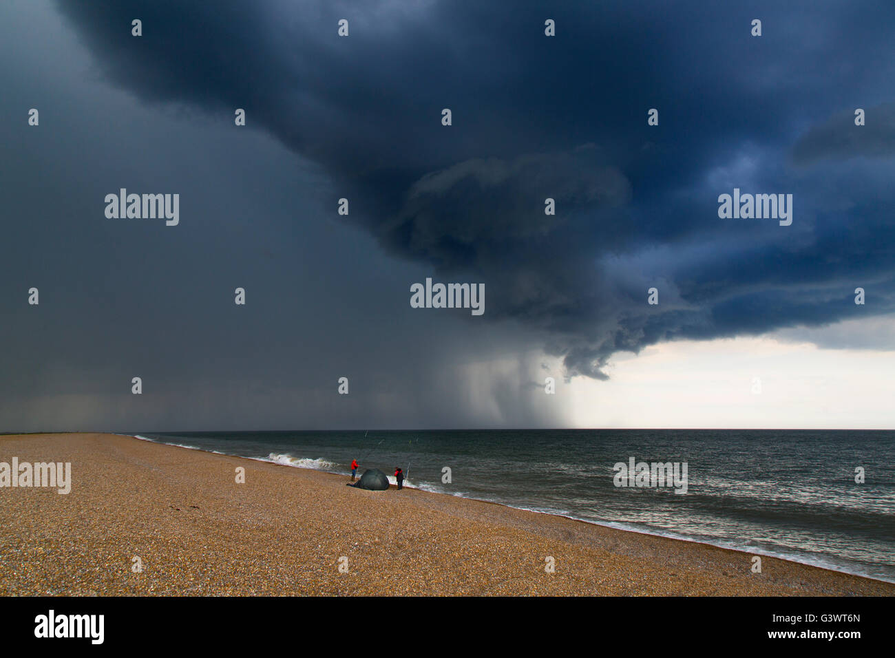 Beach Fishermen On Cley Beach Norfolk And Coming Summer Thunder Storm