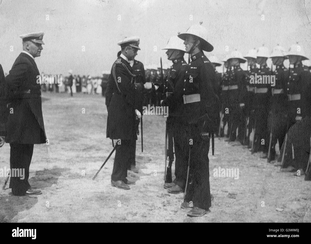 Royal Navy officers and royal marines inspected by royalty - Stock Image