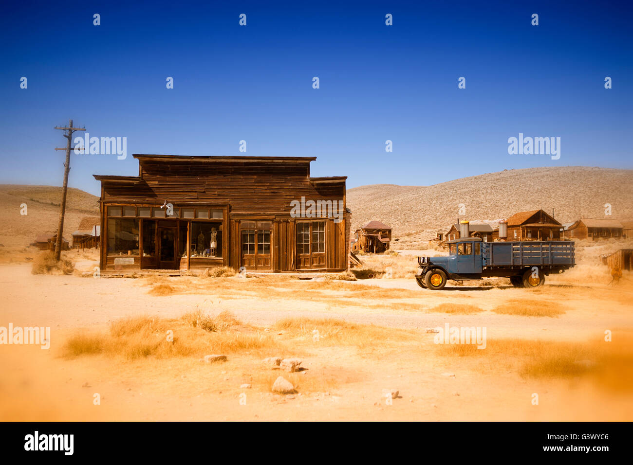 old wooden house and truck in Bodie, ghost town in California - Stock Image