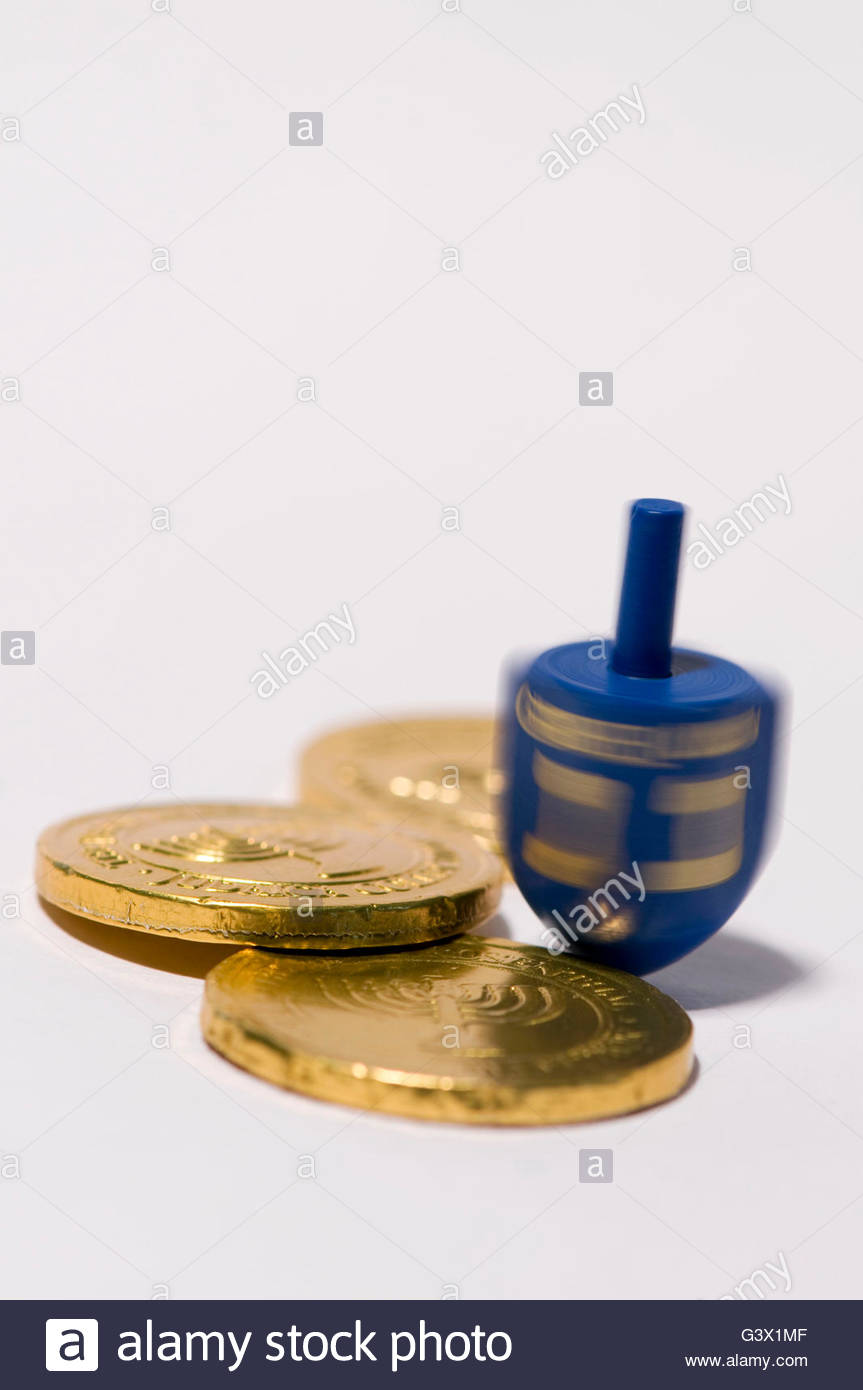 Spinning Dreidel with Chanukah Gelt - Stock Image