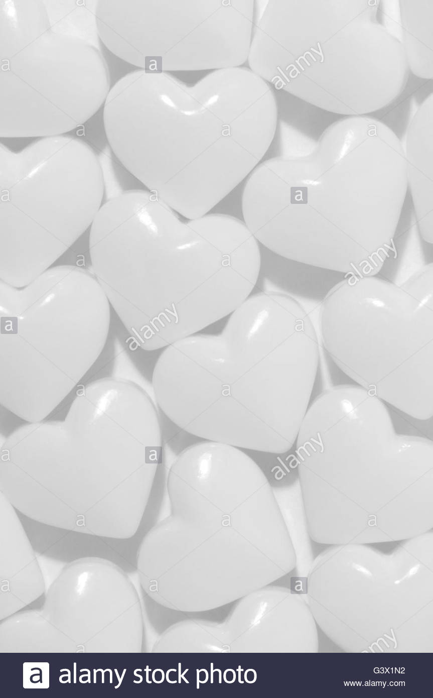 White Candy Hearts on White Background - Stock Image