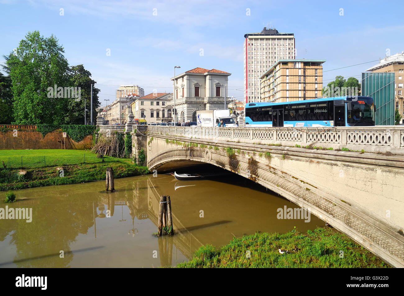 15d8315607 Padua, Italy. Corso Garibaldi street, the bridge on Piovego river. In the  background the residential area and the monument