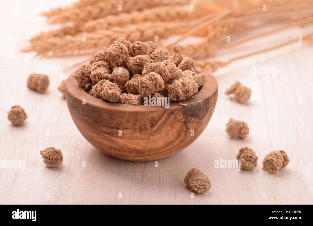 Bowl full of wheat bran and wheat ears - Stock Image