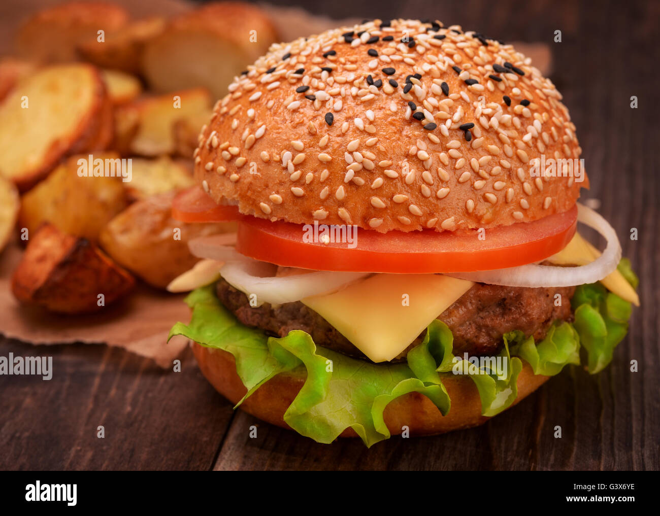 Fresh tasty burger garnished with potato - Stock Image