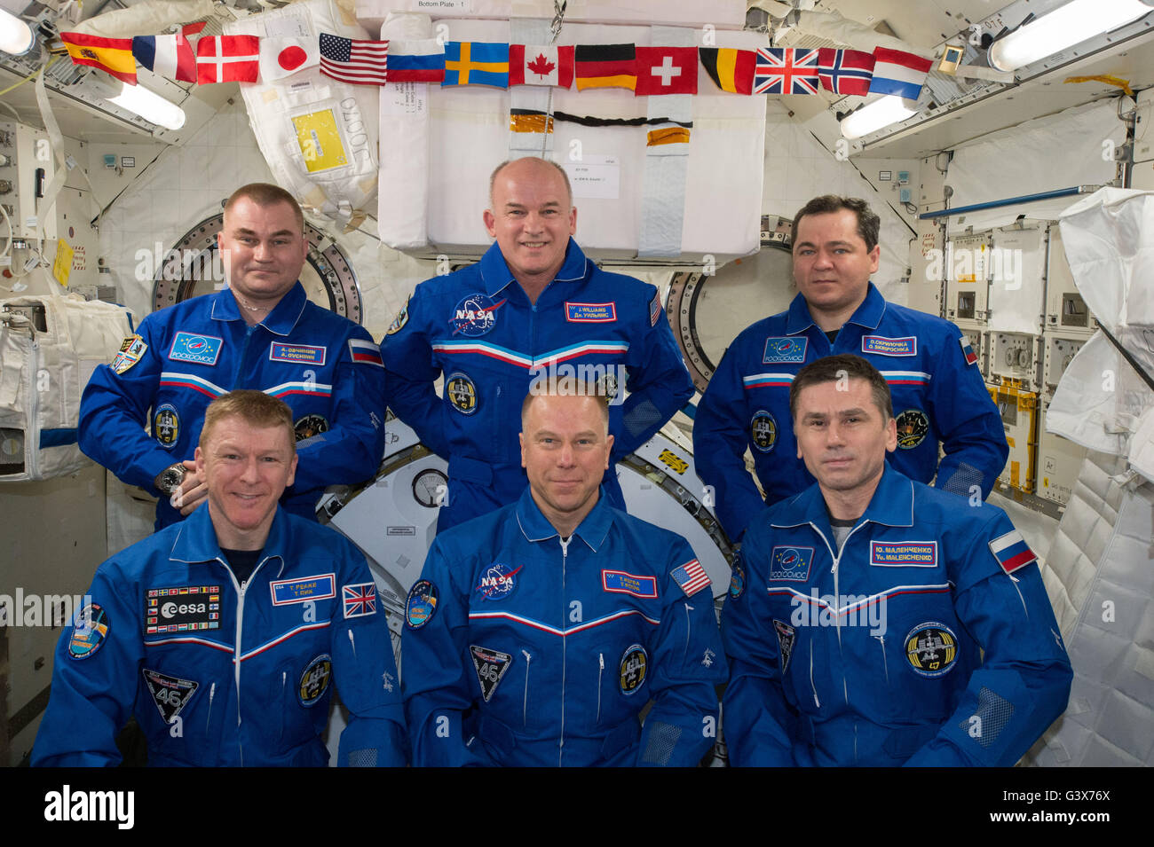 International Space Station Expedition 47 crew members pose for a group photo June 11, 2016 in Earth Orbit. Front - Stock Image