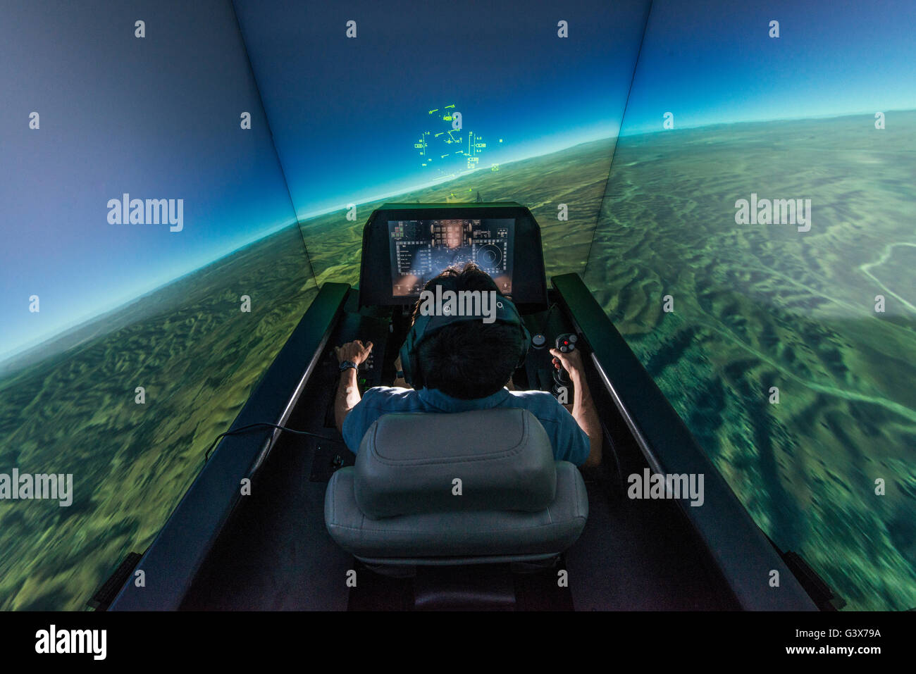 An aerospace engineer demonstrates the automatic ground collision avoidance system in the F-16 fighter aircraft - Stock Image