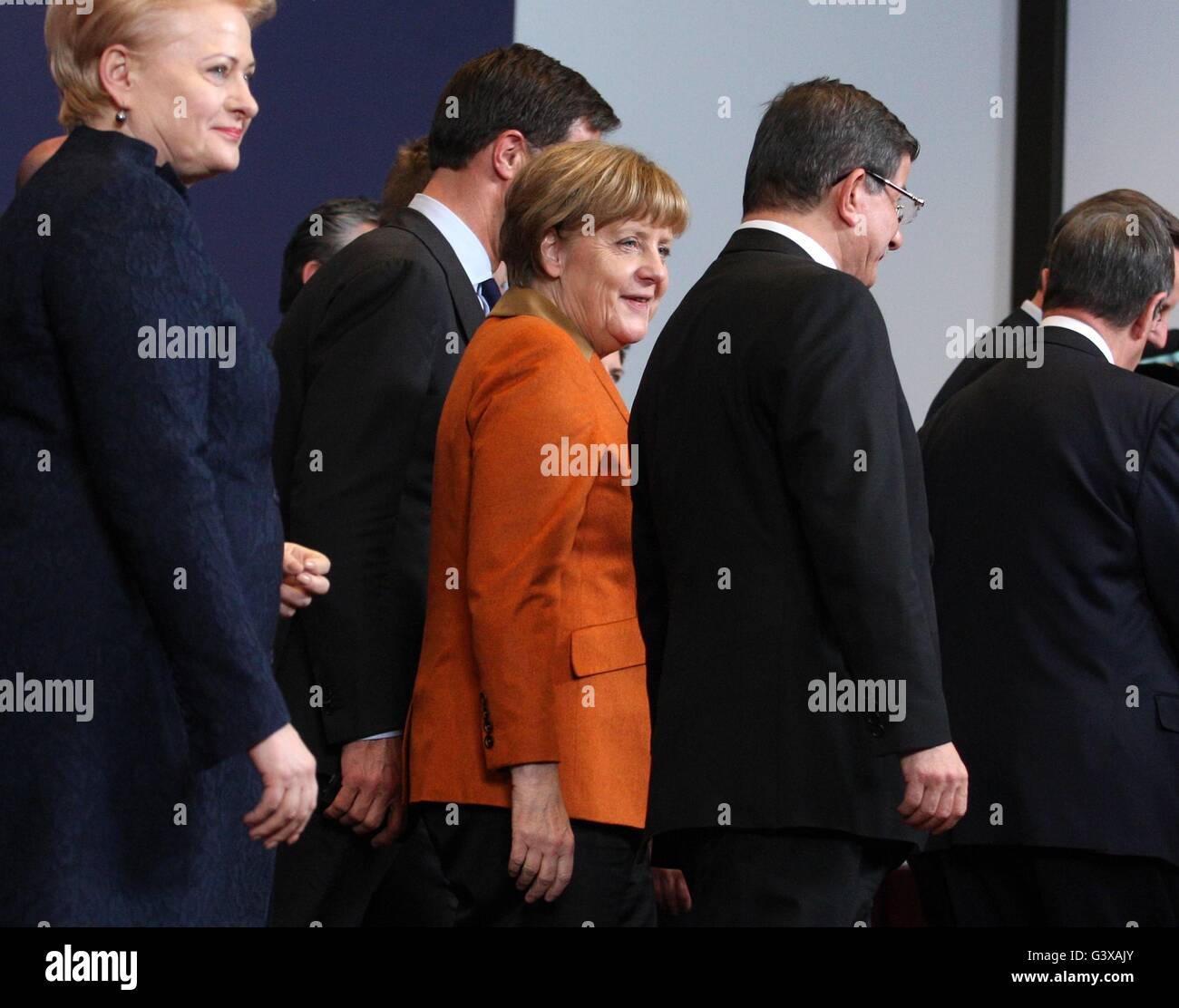 The German Chancellor Angela Merkel talks with the Foreign Minister of Turkey  Ahmet Davutoğlu after the family - Stock Image