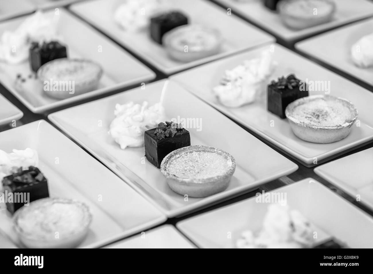 Lemon Tart, Brownie And Mouse Pudding Platter - Stock Image