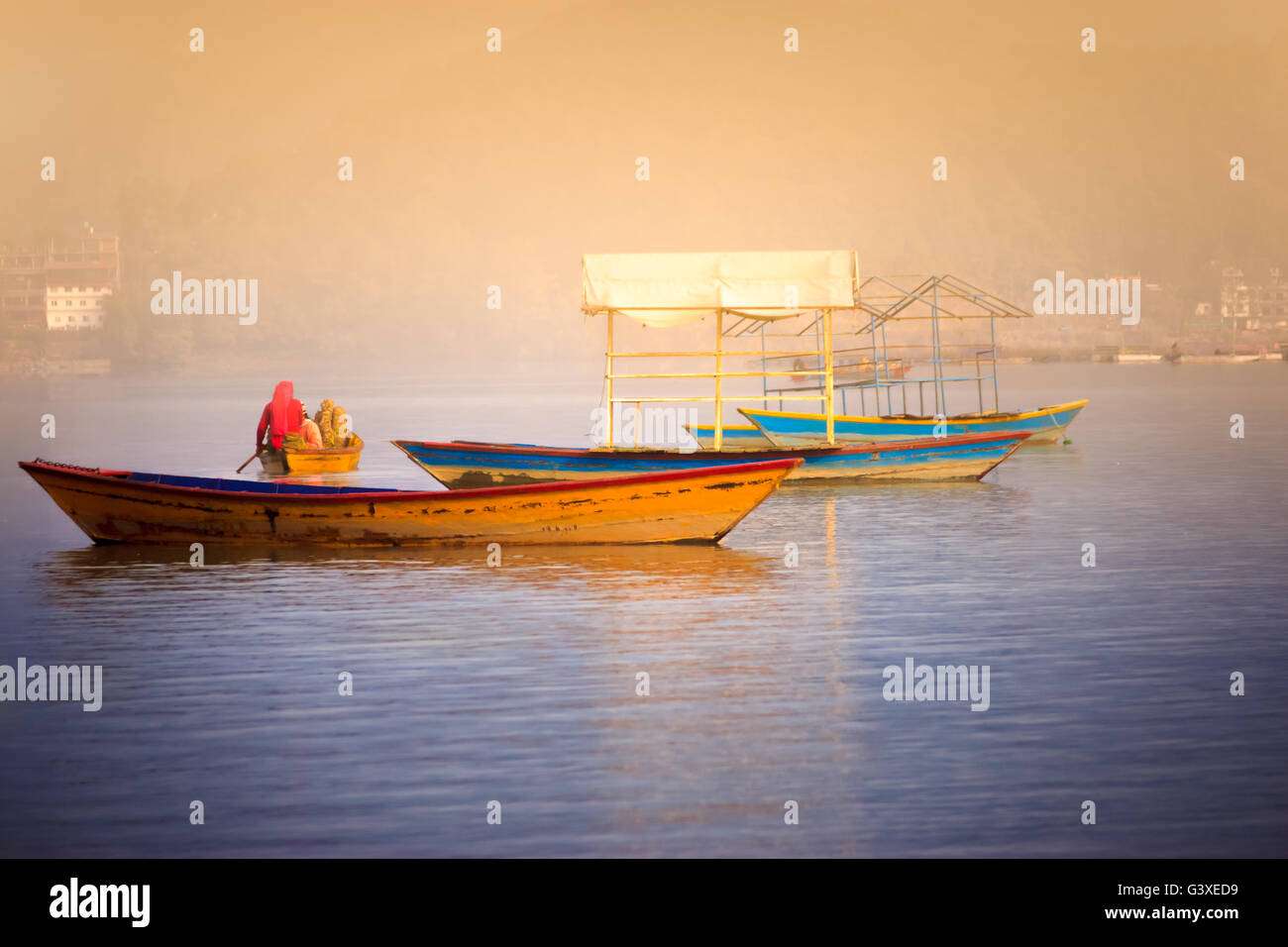 Women are taking firewoods in boat in the crisis of fuel due to the indian blockade in Pokhara,Nepal. - Stock Image
