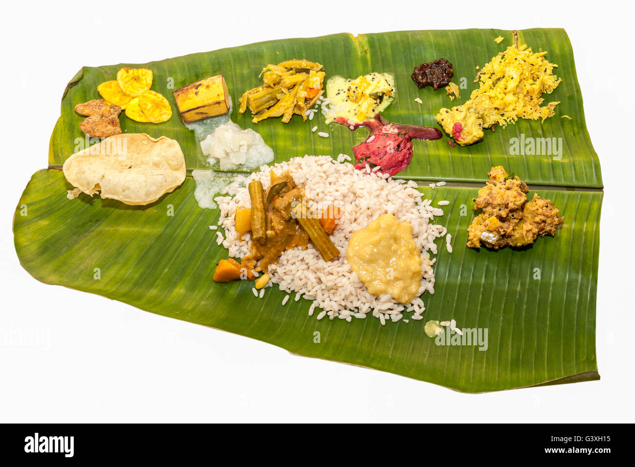 Kerala Onam Sadhya. Kerala vegeterian meals in banana leaf which is usually served on the occasion of hindu festivals - Stock Image