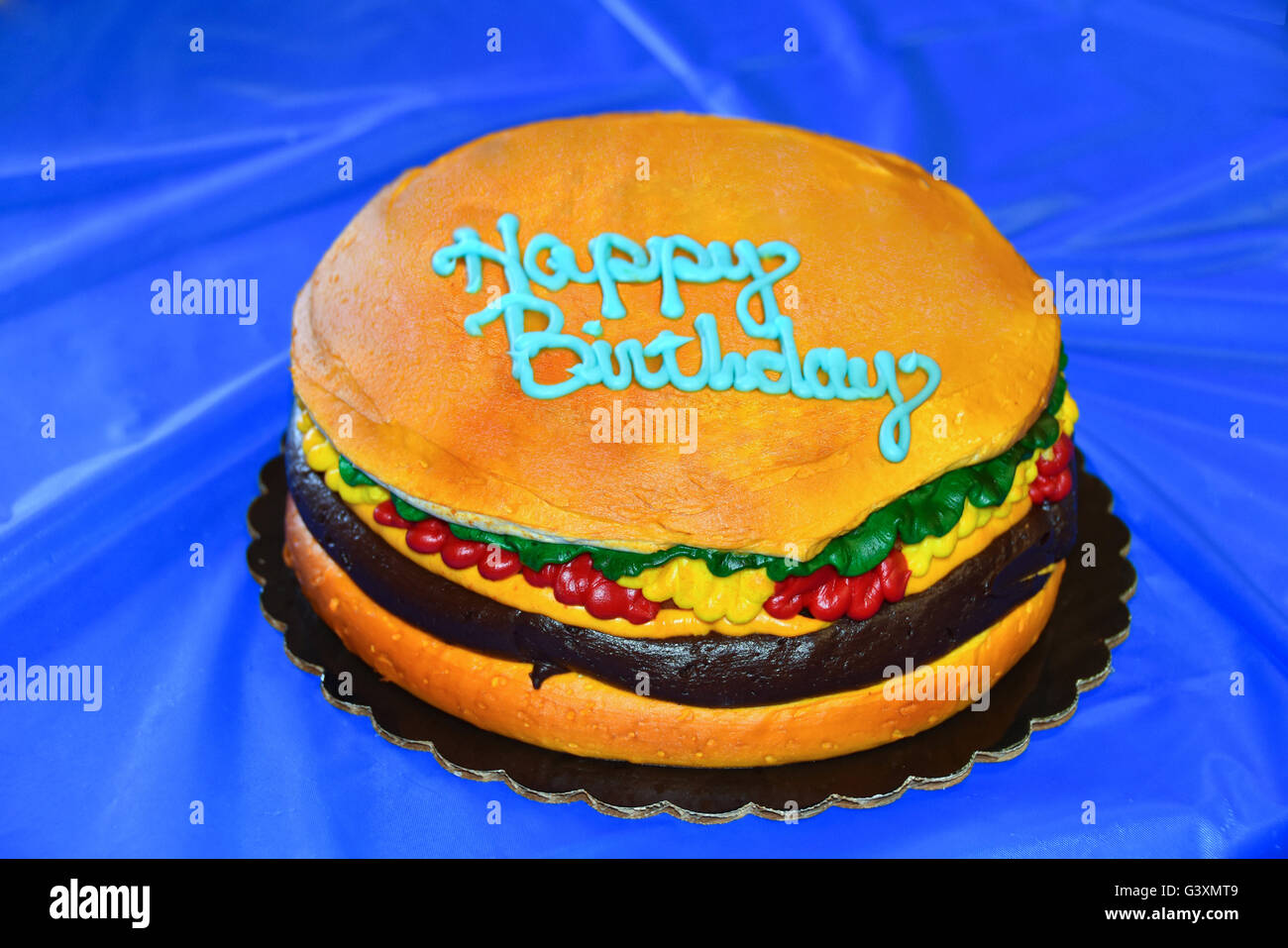 Pleasing Happy Birthday Cake In A Shape Of A Hamburger On Blue Plastic Funny Birthday Cards Online Inifofree Goldxyz