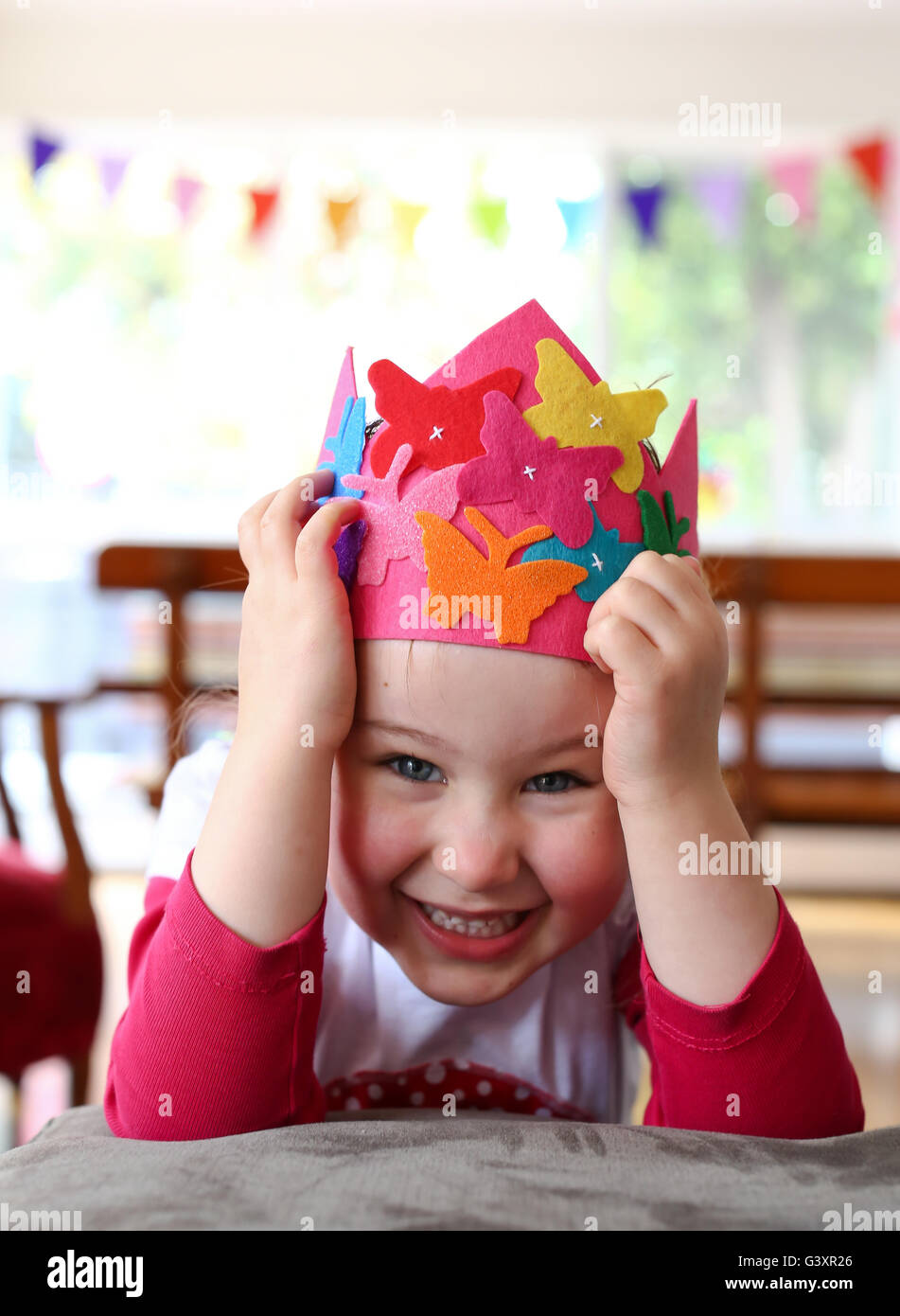 Child with party hat being silly Stock Photo