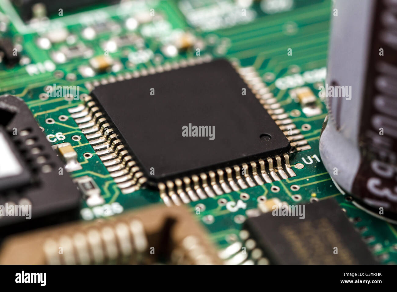 Printed circuit board with ICs, chip capacitors, and chip resistors. - Stock Image