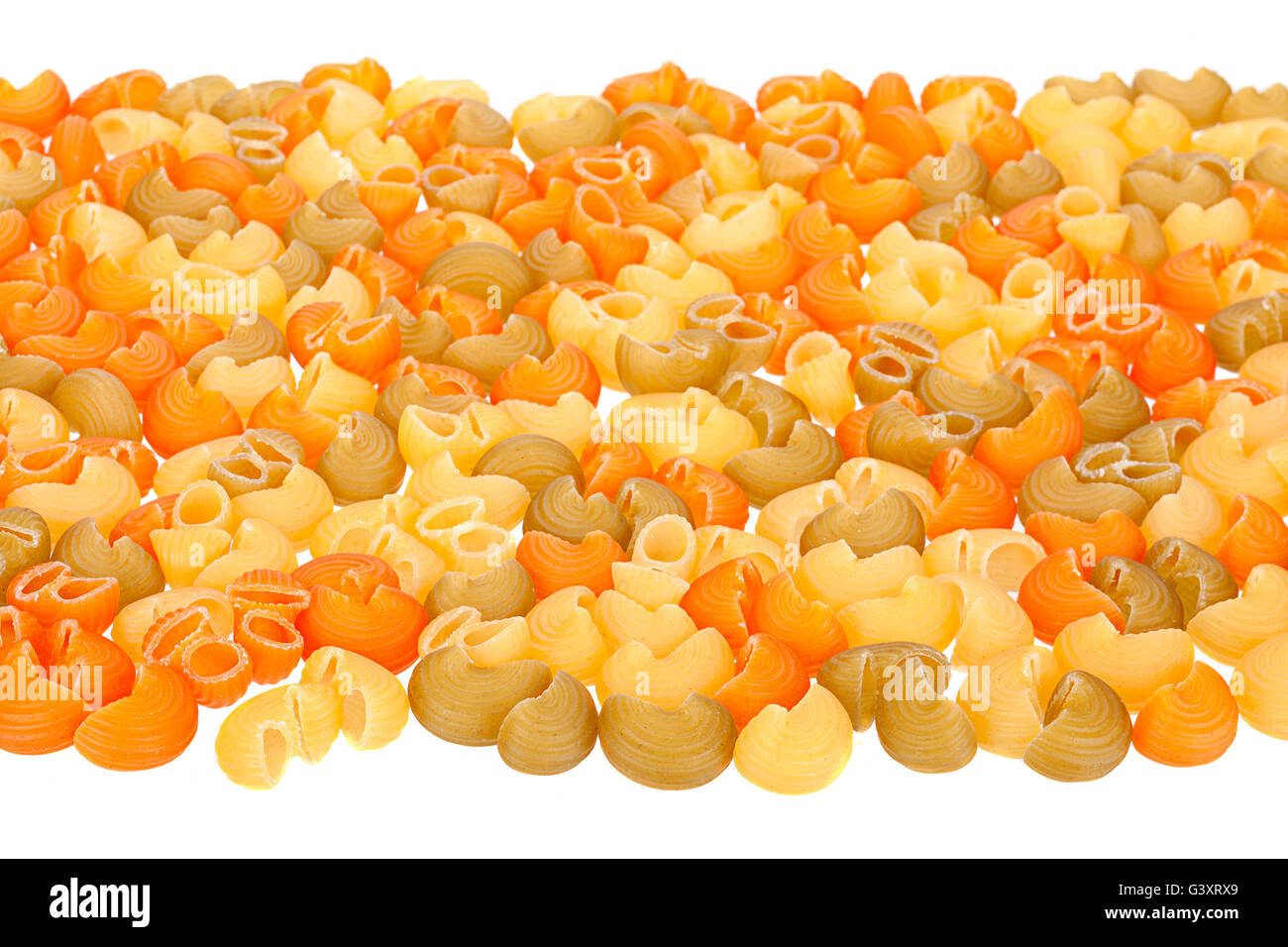 Multicolor dry swirl pasta isolated on white - Stock Image