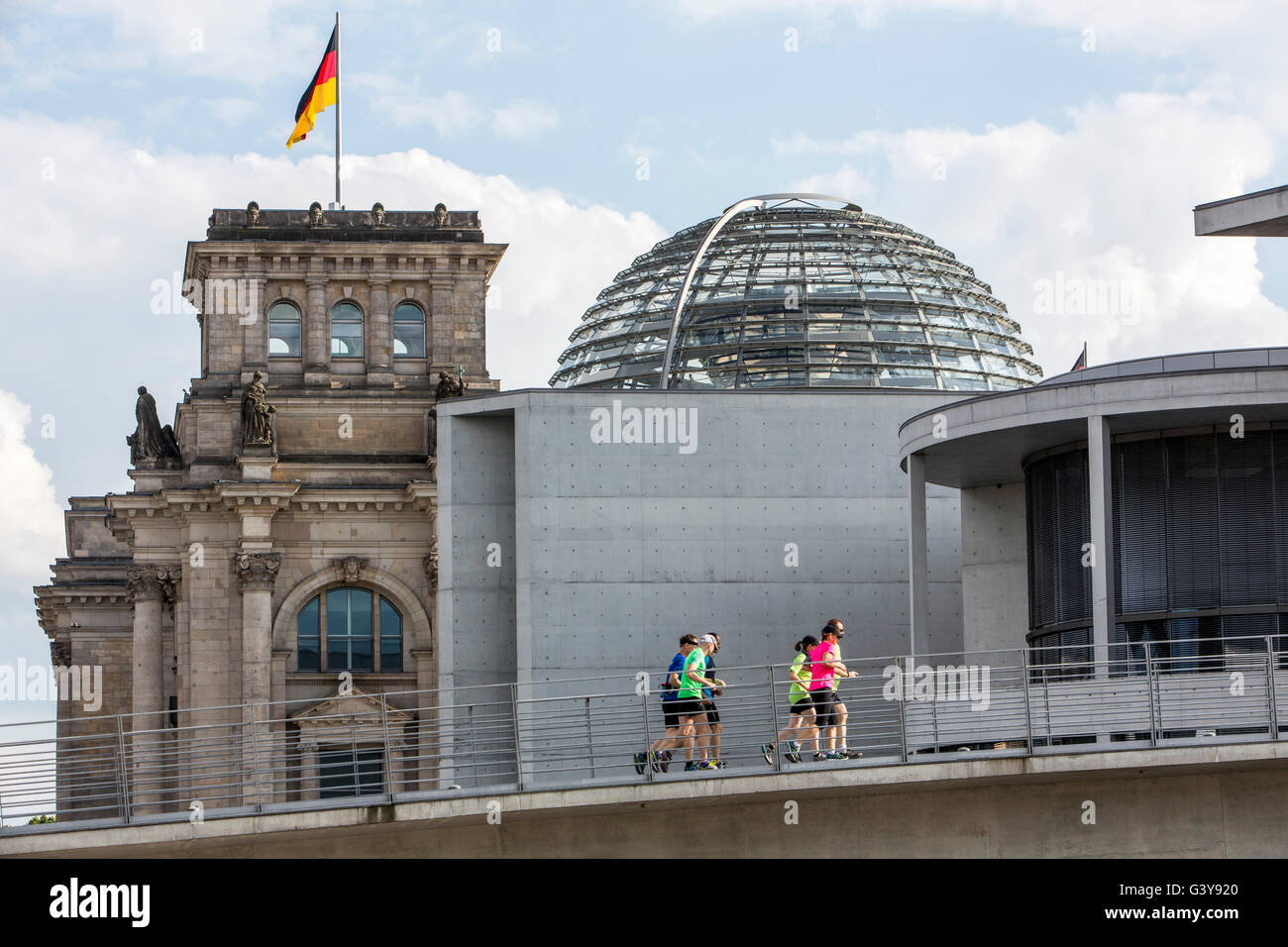 Jogger, running in the parliament district, Berlin, Germany, German parliament building, The Reichstag, - Stock Image