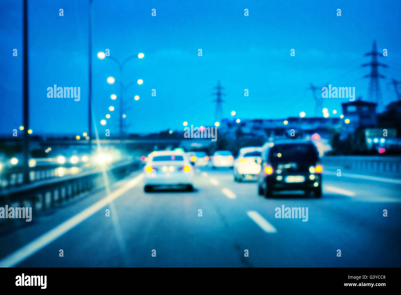 Illuminated the road car shot with blurred focus - Stock Image