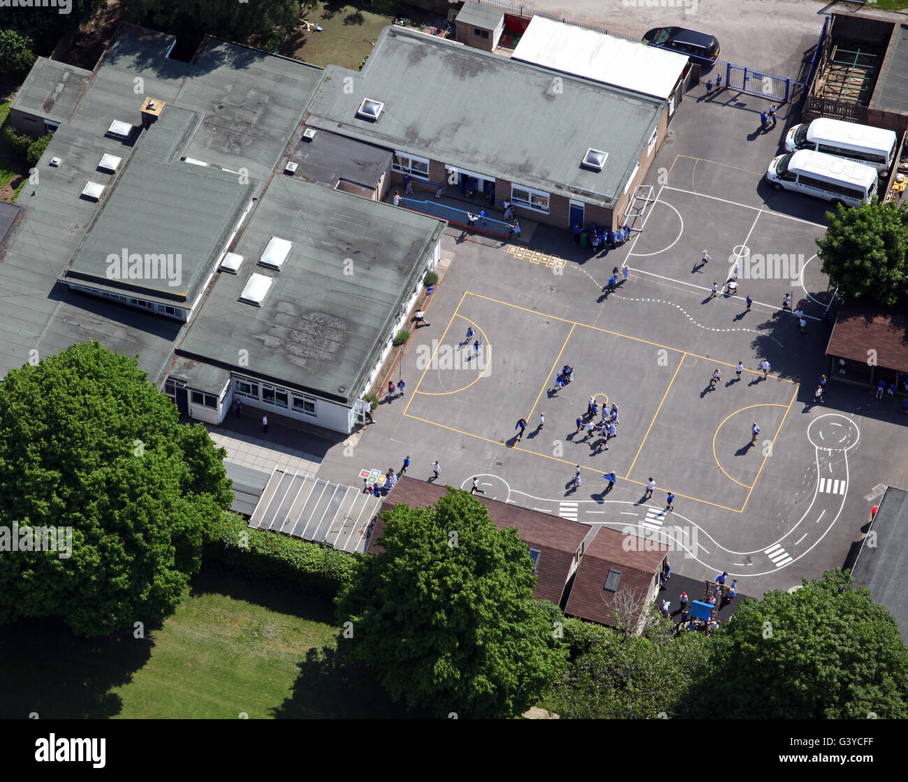 aerial view of a school playground with children playing, England, UK - Stock Image