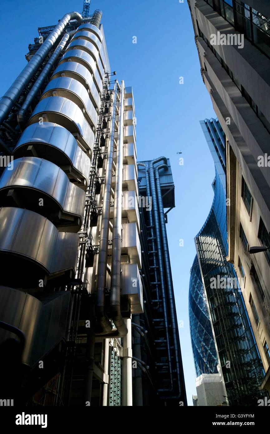Lloyd's of London and Willis buildings, designed by Richard Rogers, financial district, City of London, England, - Stock Image