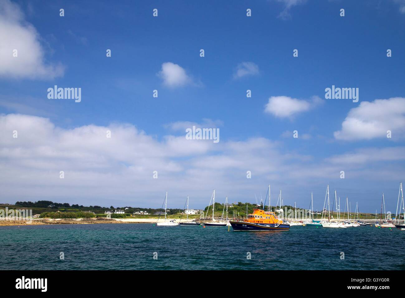 Lifeboat and moored yachts off St Mary's, Isles of Scilly, Cornwall, England, UK, GB Stock Photo