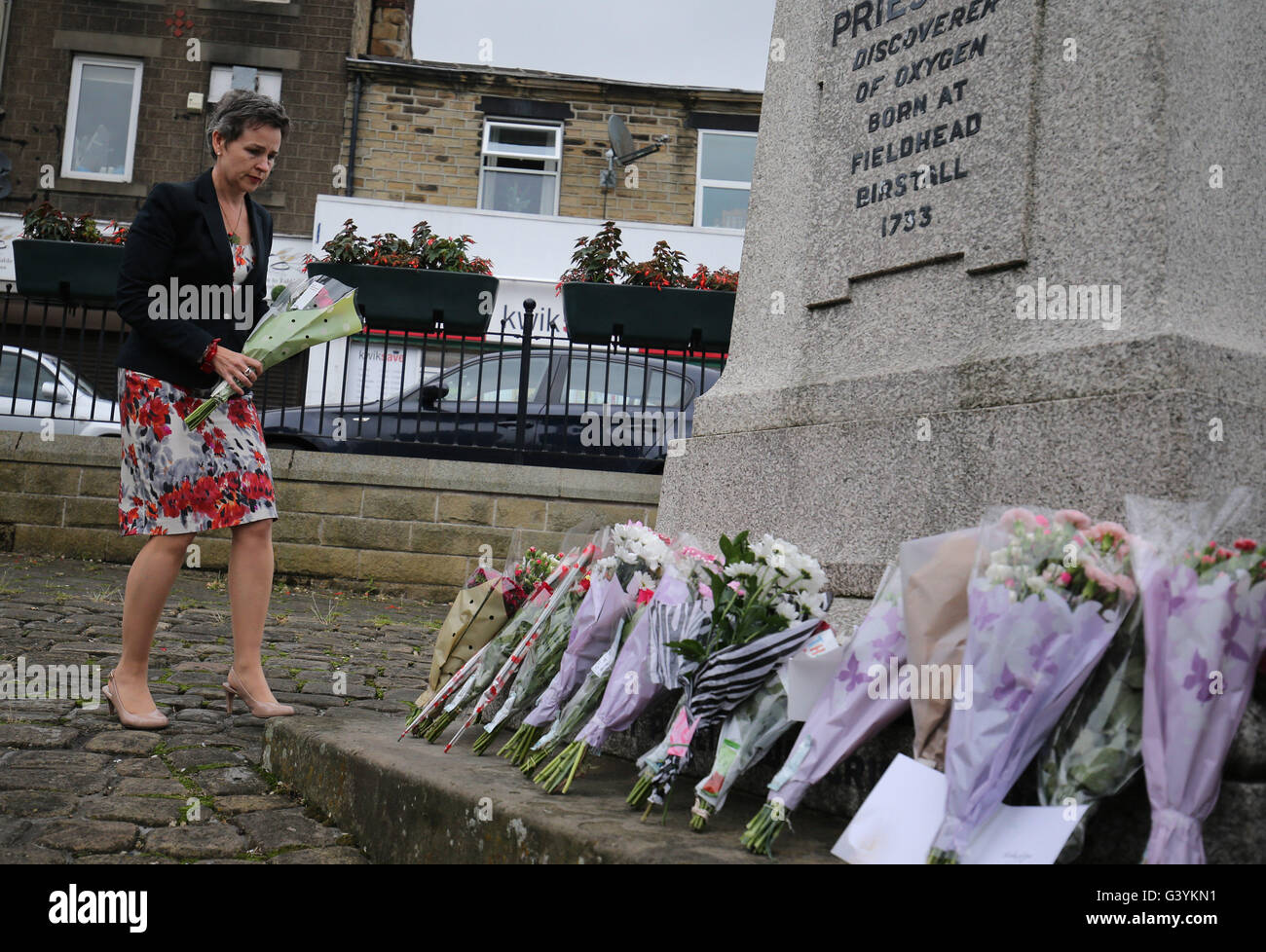 MP Mary Creagh lays flowers in Birstall, West Yorkshire, following the death of Labour MP Jo Cox, who died after - Stock Image