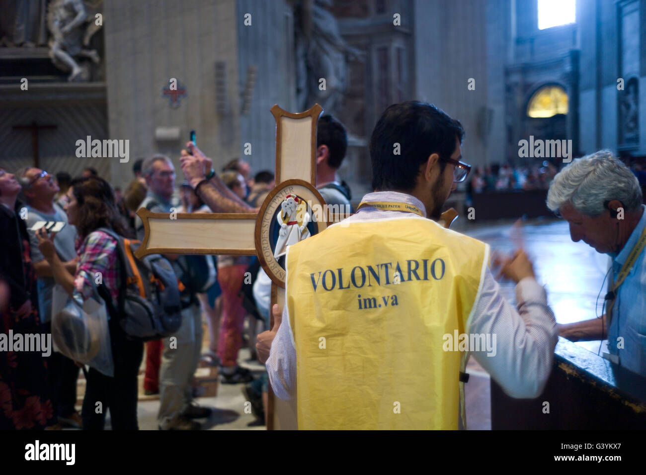 A volunteer inside St Peter's Basilica in the Vatican Rome Itlay - Stock Image