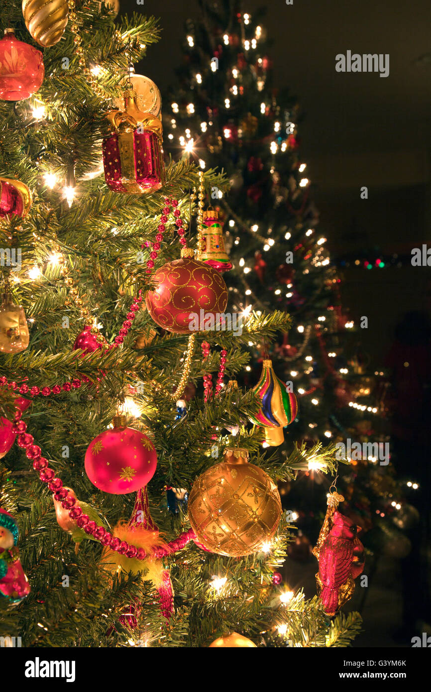 Christmas tree decorations with reflection in background. - Stock Image