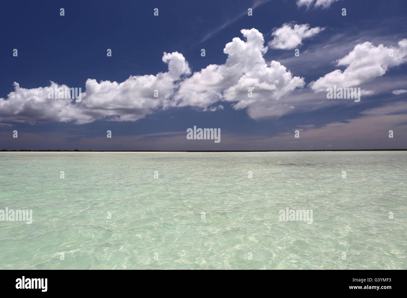Blue sky and fluffy clouds over lagoon, Christmas Island, Kiribati - Stock Image