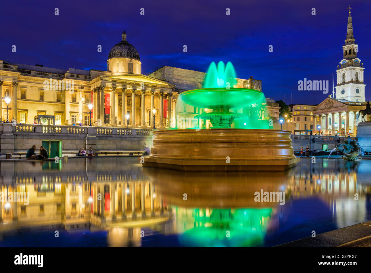 The National Gallery and Trafalgar Square at night in London - Stock Image