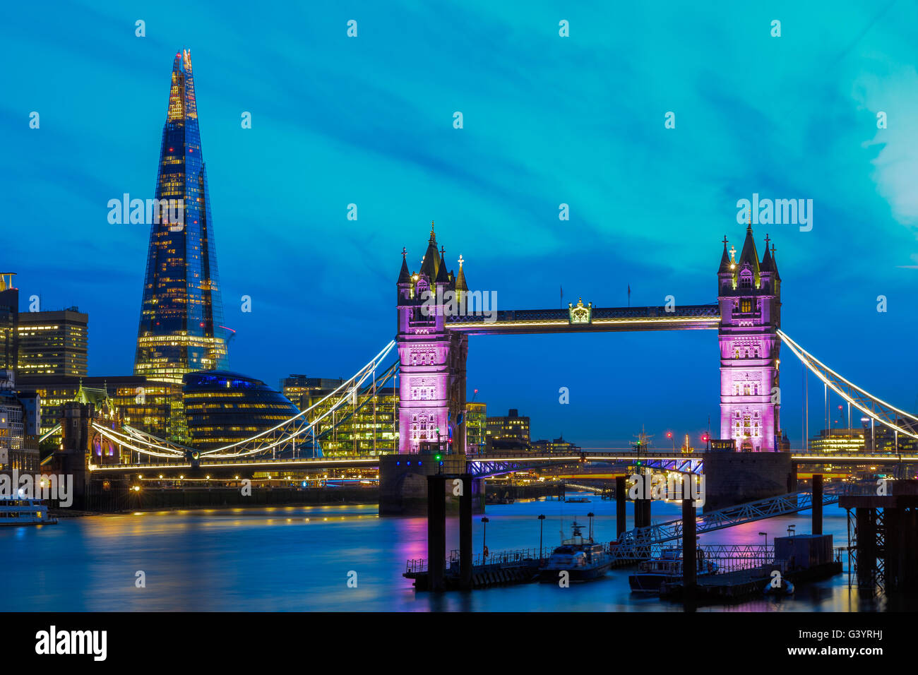 London skyline at night with Tower Bridge - Stock Image