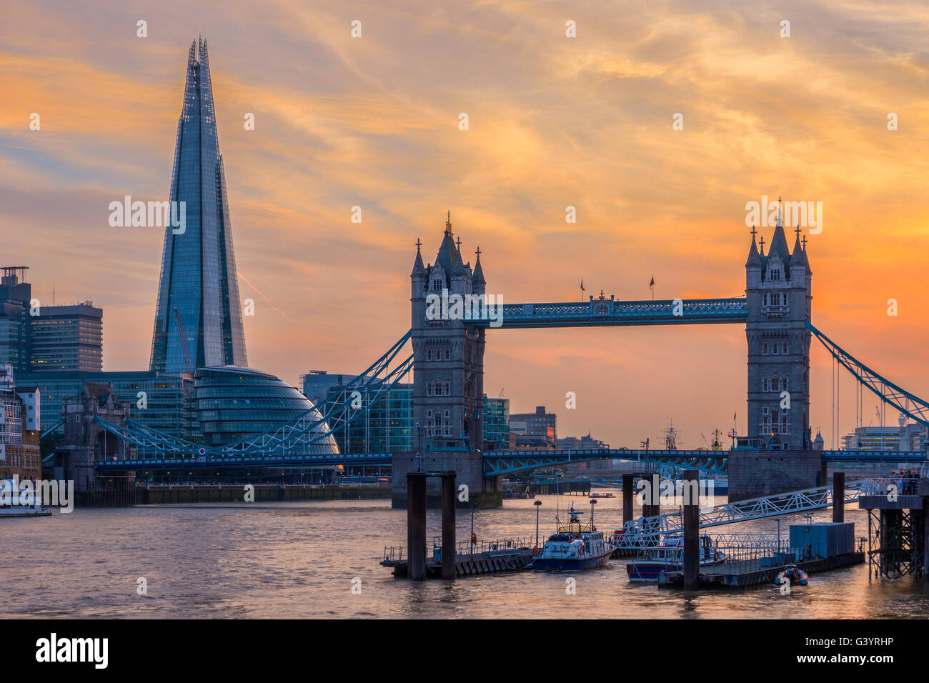 London skyline at sunset with Tower Bridge - Stock Image