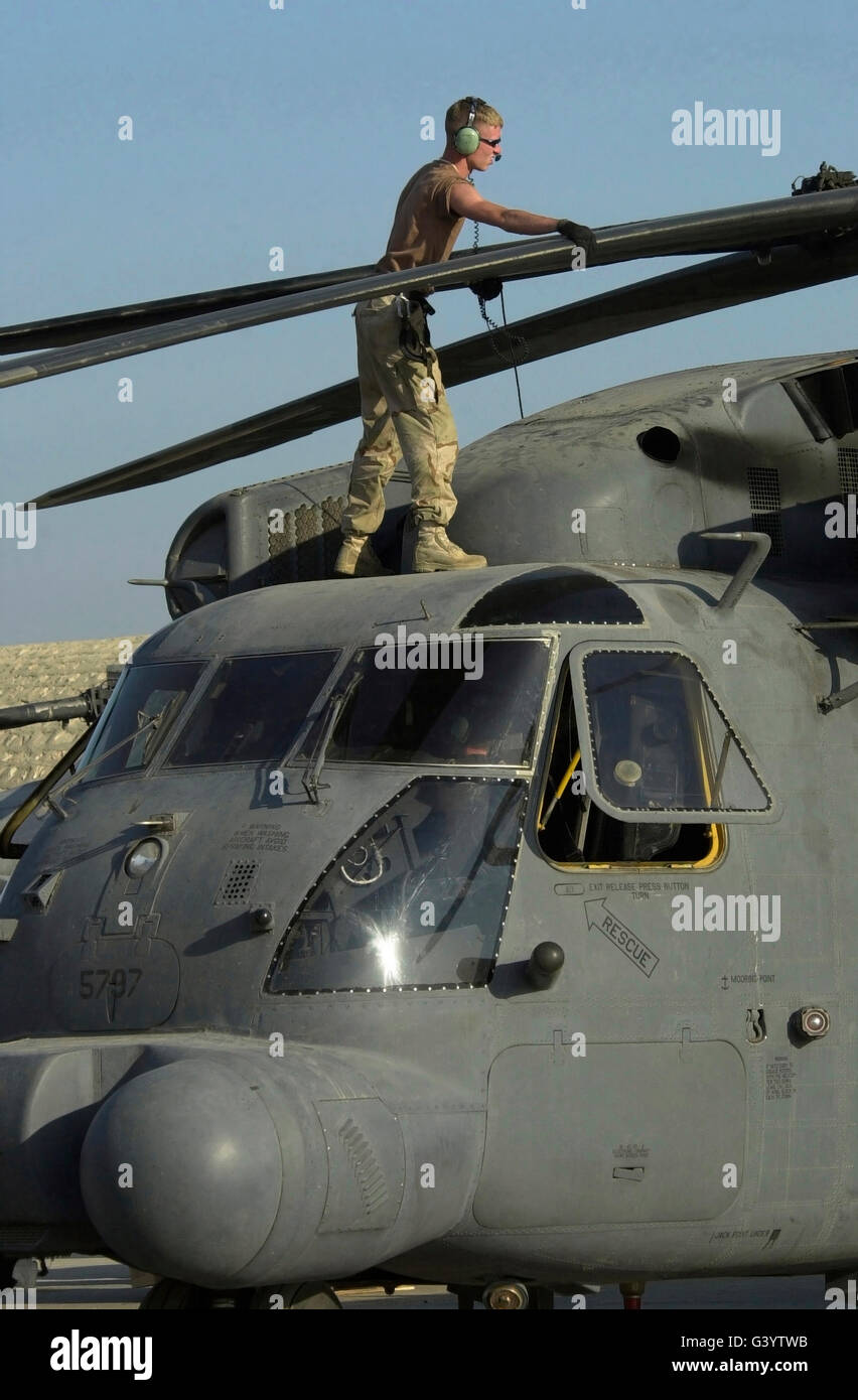 Specialist checks the folding system on a MH-53J Pave Low III helicopter. - Stock Image