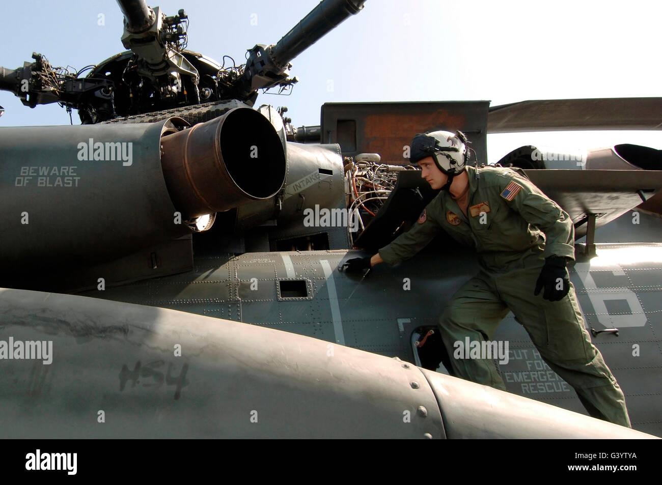 A pilot performs a preflight inspection on a MH-53E Sea Dragon. - Stock Image